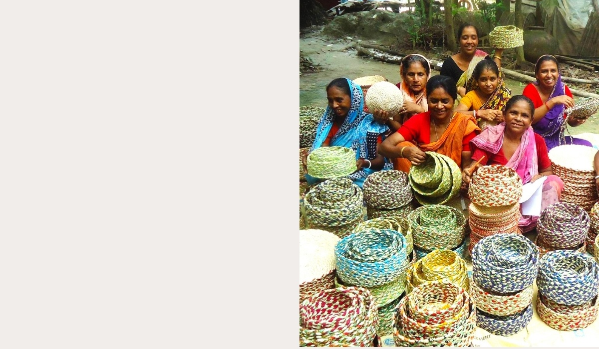 Several artisans holding different colored baskets