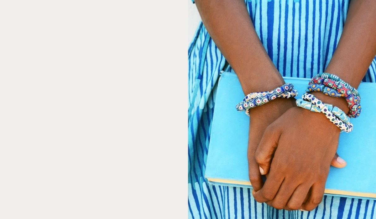 Woman holding a light blue handbag