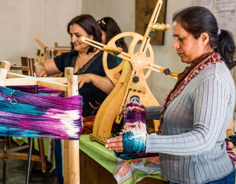 Craftswoman holding a dyed skein of wool