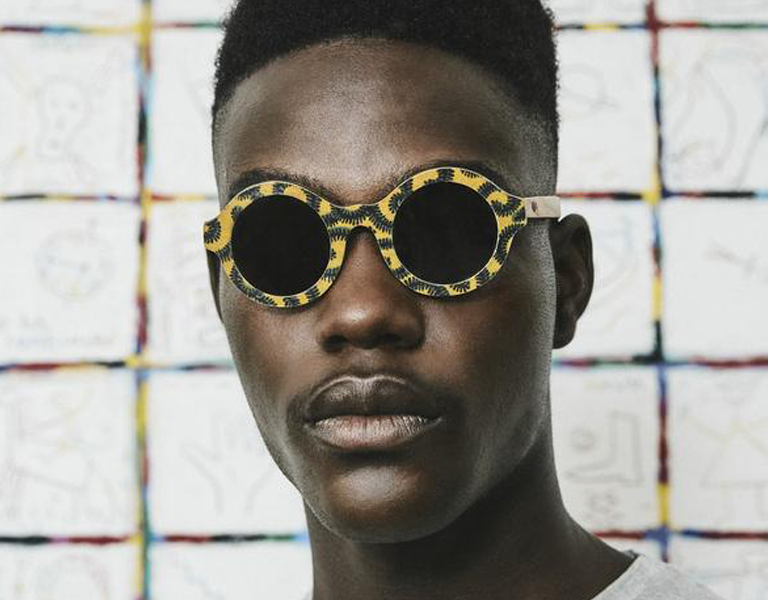 Black man wearing Ballo round upcycled sunglasses