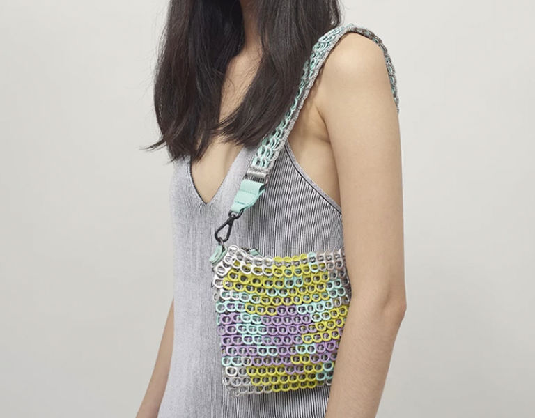 Person holding sustainable upcycled Bottletop bag.