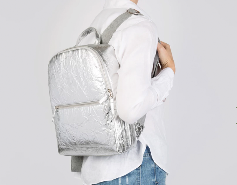 Person holding sustainable Pinatex, Luxtra backpack