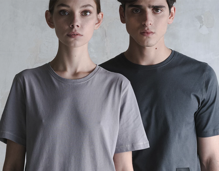 image of a woman and man wearing grey t-shirts against a grey background